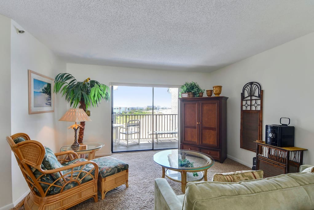 Glass doors lead to the wide balcony from the living area.