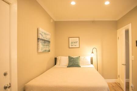 Separate bedroom with queen bed