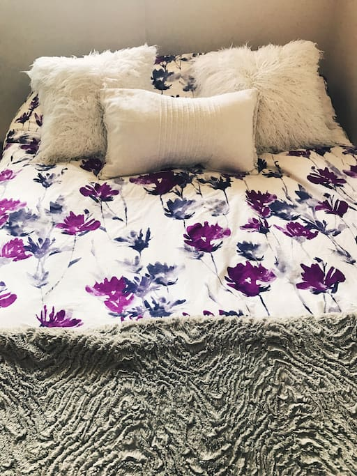 Enjoy a good night rest on our plush queen size bed with tons of extra blankets and pillows!
