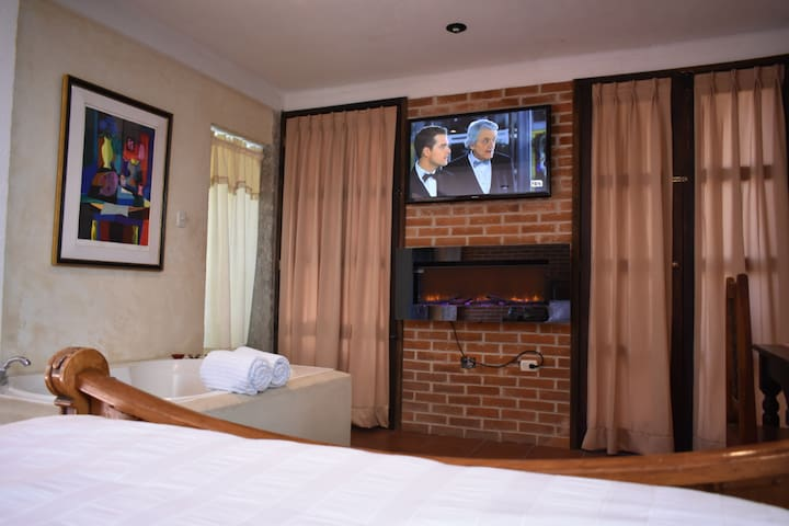From the bed or the Jacuzzi you can watch TV or Netflix and stay toasty warm with an electric fireplace.