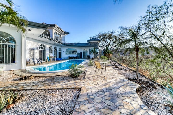 Luxury hilltop home w/private pool/ patio + ocean views - close to the beach!