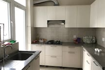 Kitchen with functional gas, fridge, water filter, cutlery, glasses etc.