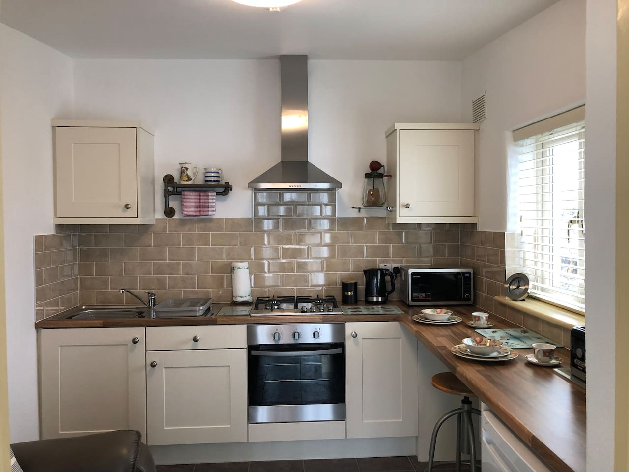 Fully equipped kitchen with breakfast bar overlooking the views of the village.  There is also a settee and TV located in the kitchen. Full WFI throughout the apartment.