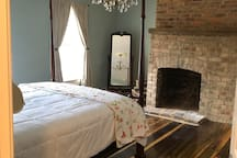 South bedroom with an antique queen size bed and Roku TV!