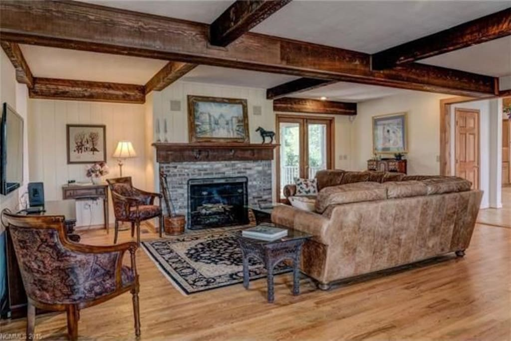 Great Room with fireplace, wet bar, and wide screen TV