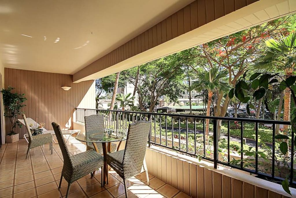 Spacious lanai with garden view just steps to beach.