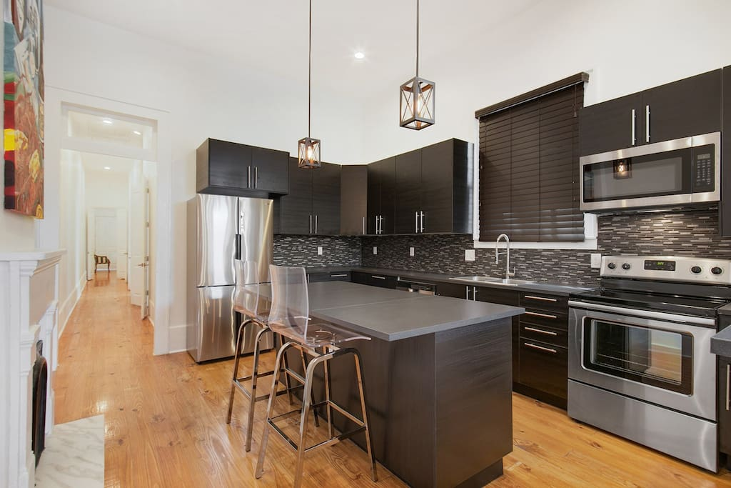 Well appointed kitchen with all stainless appliances! Coffee maker, toaster, microwave, oven, stove and all the necessary utensils, plates etc. to enjoy a great meal with family & friends!