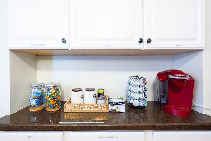All of our guests have access to a coffee corner - with a deluxe Keurig coffee machine, premium teas, as well as complimentary snacks.