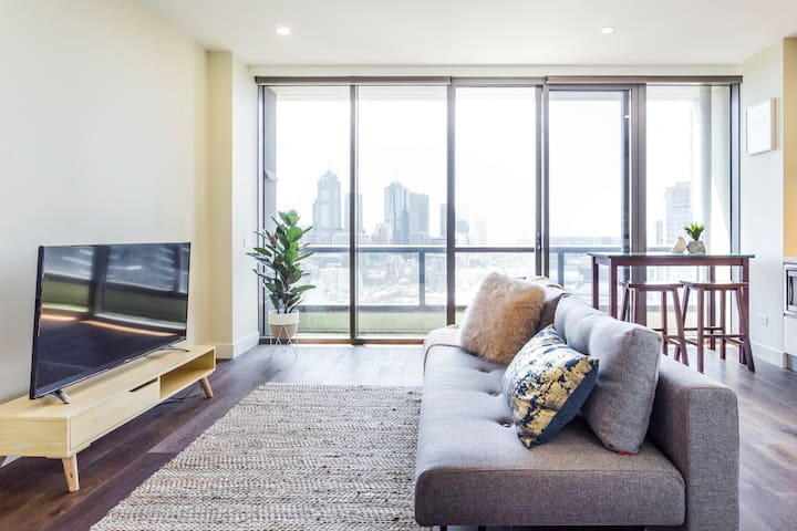 Admire Melbourne from a High-Rise Apartment