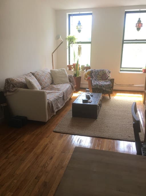Light-filled, roomy living room. Sleeper couch pulls out to a king sized bed.