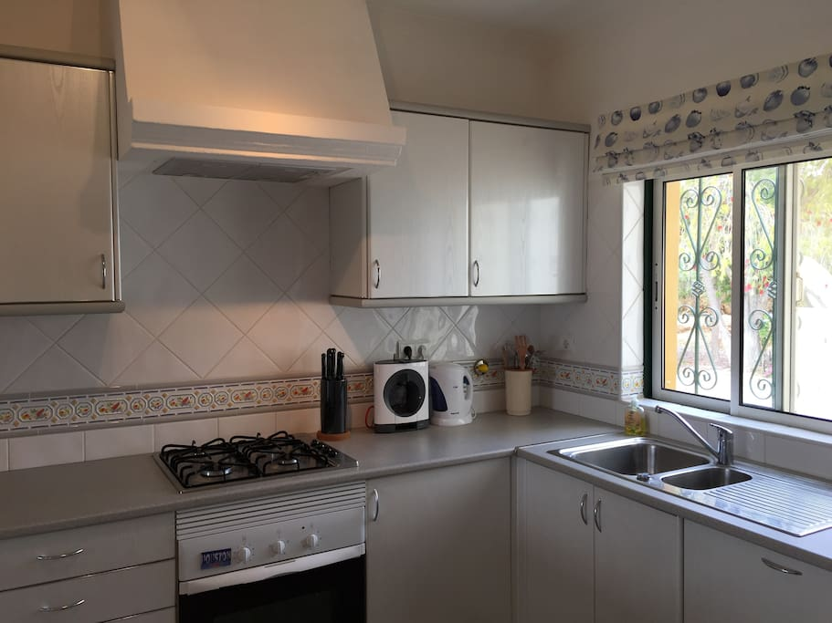 Large kitchen with gas cook top, kettle, toaster and Nescafe Dolce Gusto coffee maker.