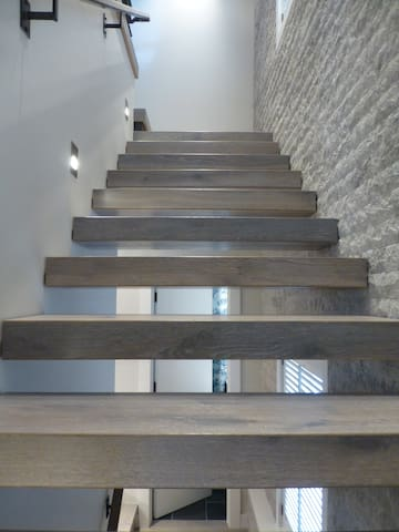 Custom stone and floating stairs