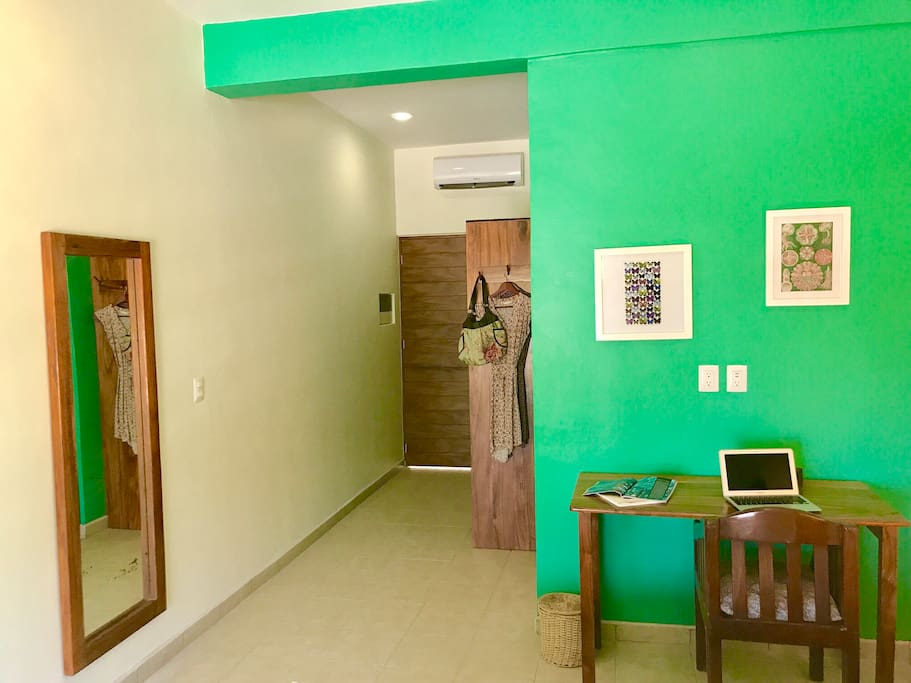 Desk, closet and mirror are among the modern amenities