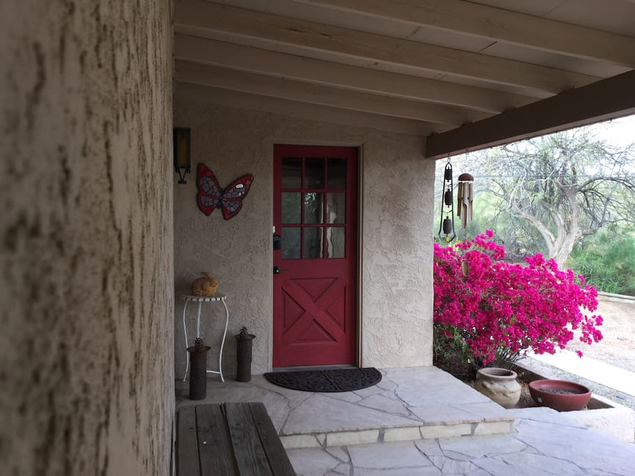 """Red door"" front entrance with keypad."
