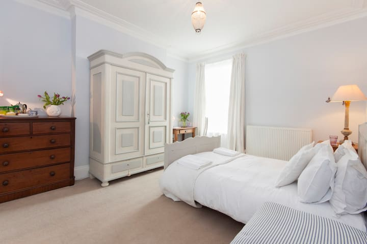 The bedroom is bright and airy. as seen in this photo.