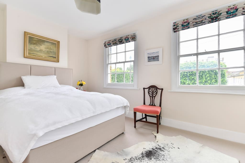 The bedroom with comfy double bed and wonderful views out of the large windows.