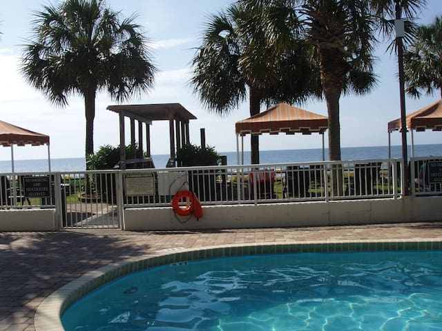 Heated pool year round. Lounging chairs in the grass, some with cabanas, some for sunbathing, view of the ocean, outside shower. Fun background music while you rest and play. Life is good!