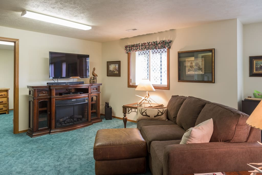 Living room with 45 inch TV. Dish service for viewing. Electric fire place that really heats the room. Comfortable queen memory foam mattress in the sofa sleeper.