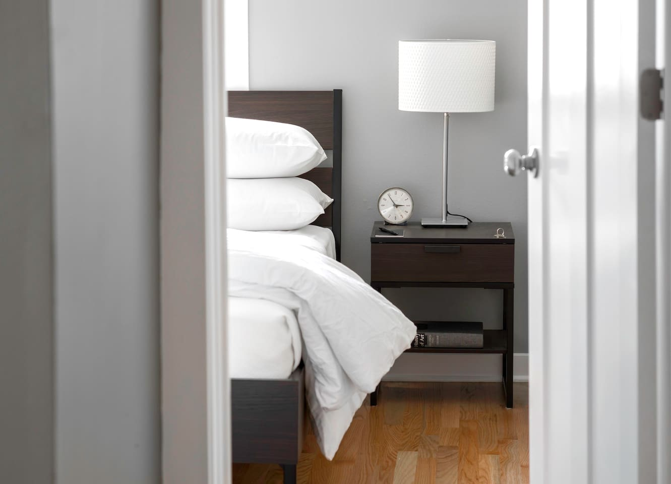 Bedroom accommodates two guests in a queen size bed.