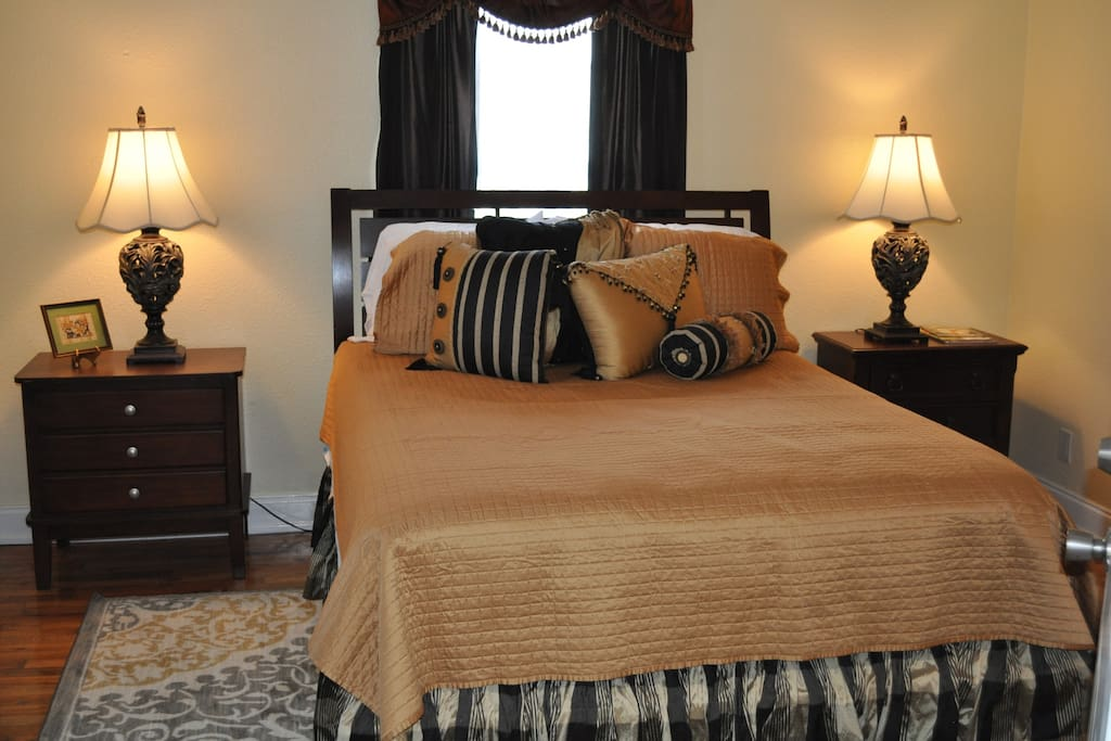 Very comfortable queen sized bed with side tables and a dresser for storage.