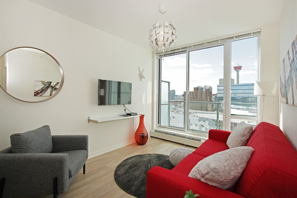Fabulous views from the living room of the Calgary Tower, Rocky Mountain and downtown