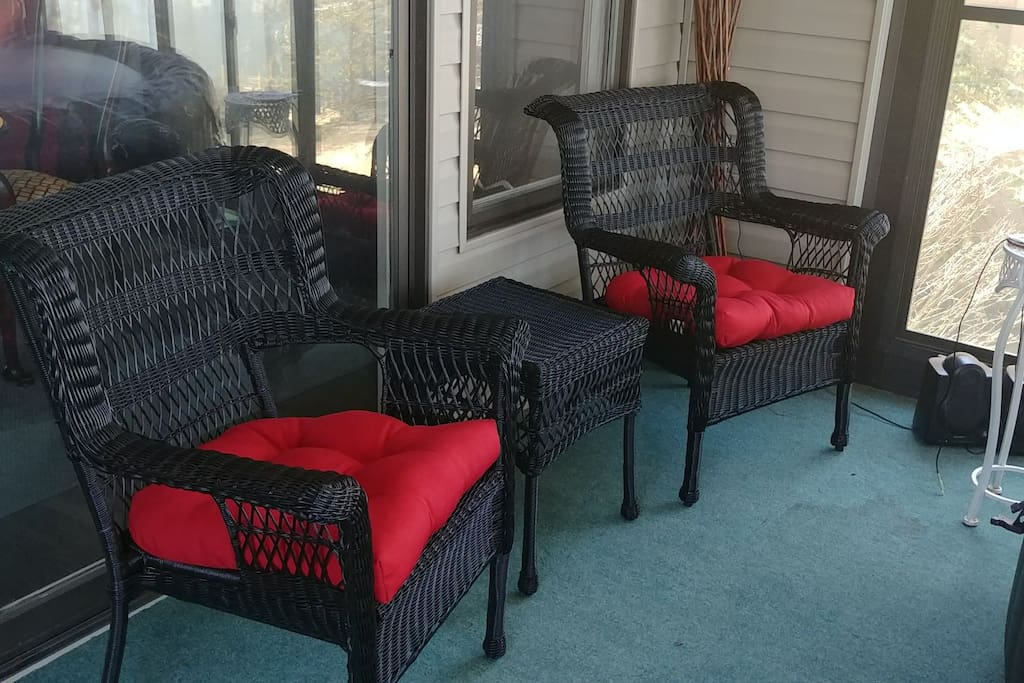 chairs in patio by hot tub