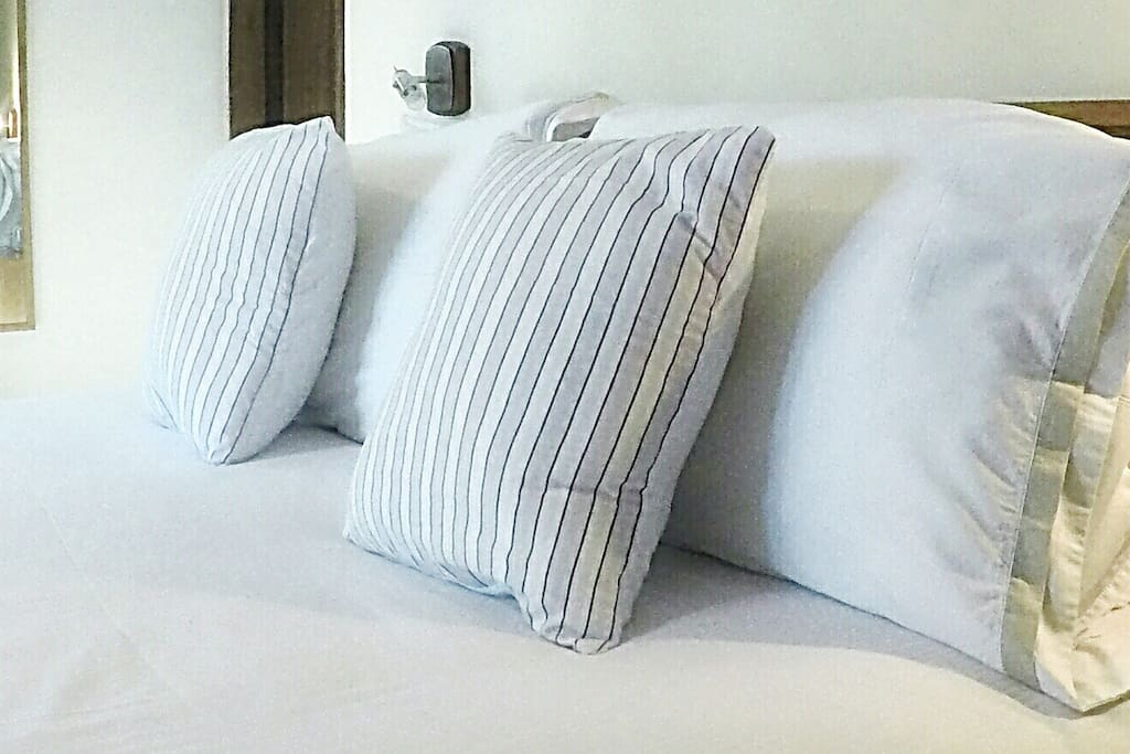 Soft, fresh bedding and loads of pillows welcome you.