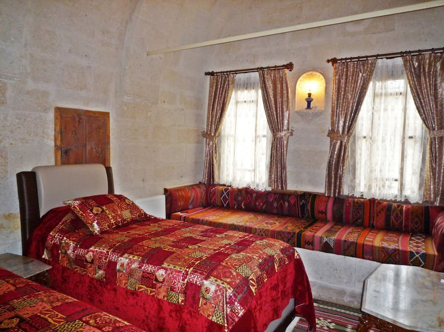Seljuk Suite second bedroom with twin beds and traditional seating that can become another bed.