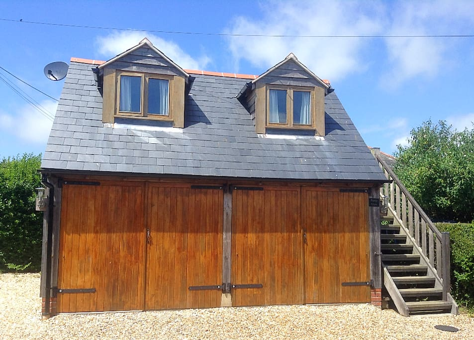 Pump View sits on the top floor of this cosy cabin, which is nestled in the Dorset countryside.