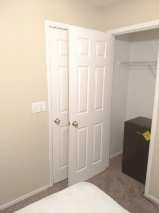 Private Bedroom W/ Mini Refrigerator in the closet. Door enterance behind when closet door is shut.