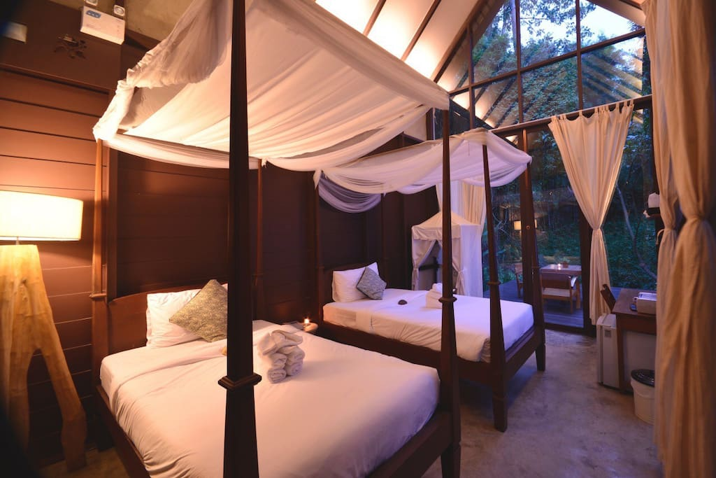 Comfortable two single beds in your private villa.