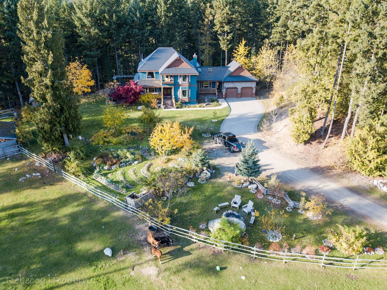 aerial image of the firepit, garden and main house