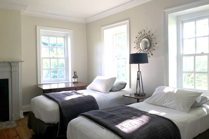 The White Bedroom 1 is on the ground floor with 2 twins and 1 queen size bed