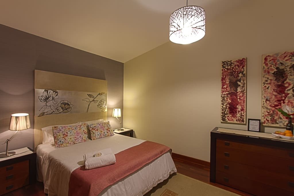 Your comfy room with a double bed.