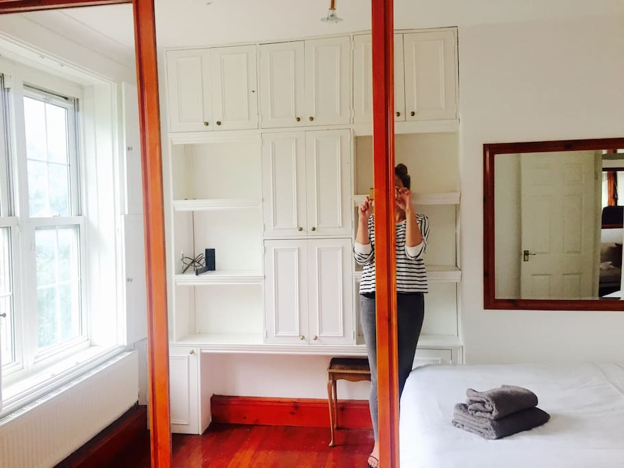 Large mirrored wardrobes with lots of cupboard space