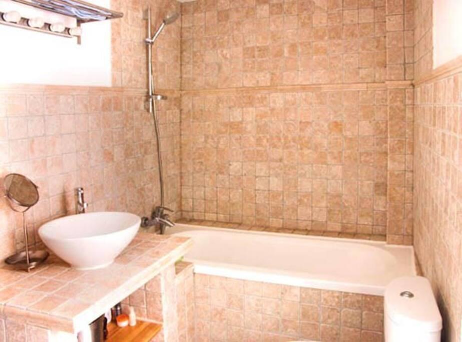 En suite bathroom with shower and bath.