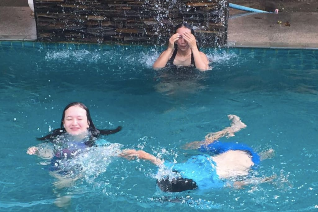 Adults and children playing in the pool. A great depth for swimming and relaxing