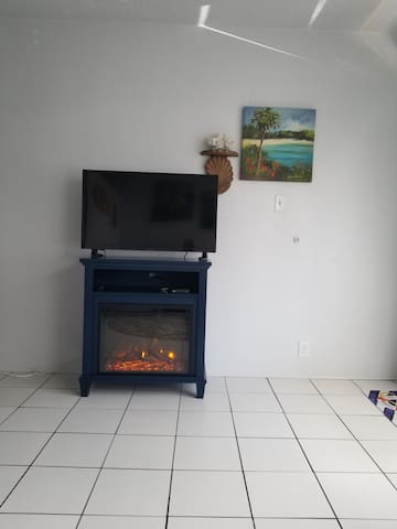 An electric fireplace for warmth or ambiance.