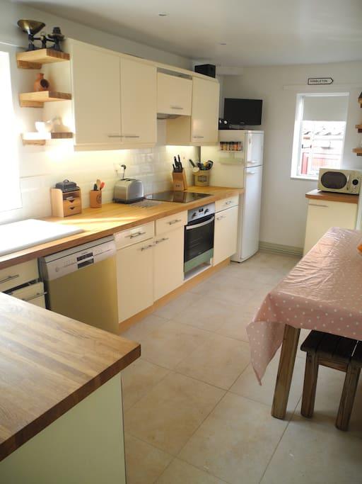Kitchen with dishwasher, washing machine, induction hob & oven