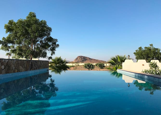 Deluxe cabin farmstay with pools in heart of Oman