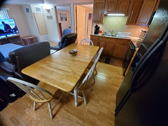 The dining table is shown with the flip-up leaf in position.