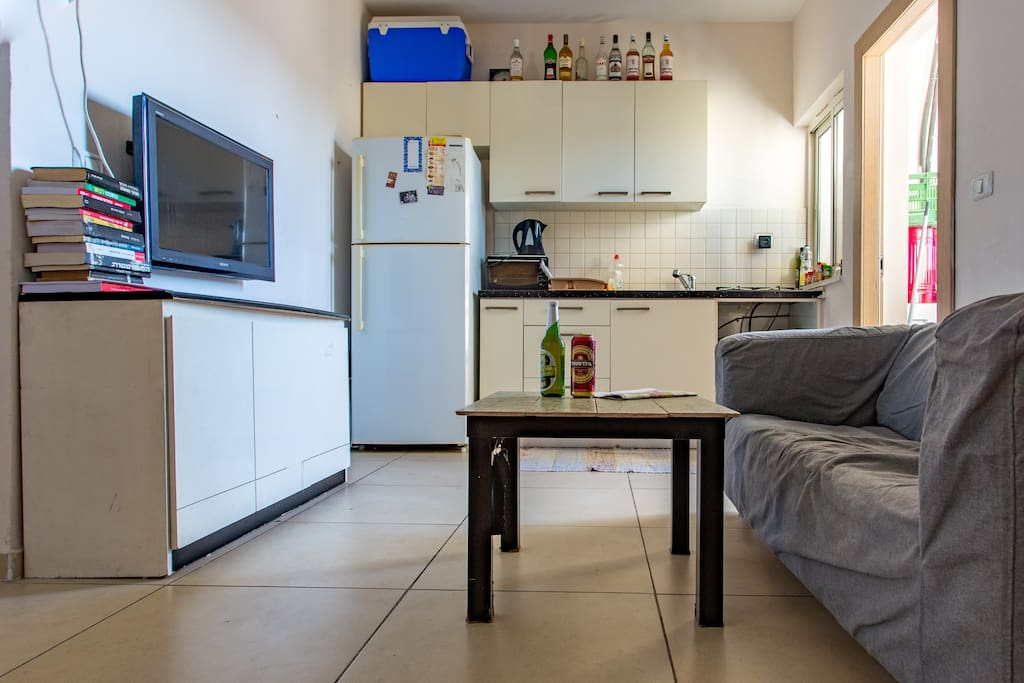 This is our kitchen. And mini living room, you can chill here when its too warm on the roof