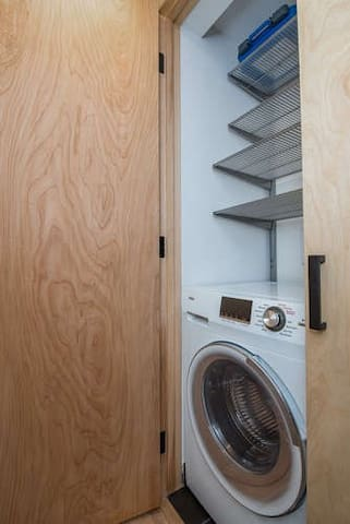 Closet with washer/dryer combo unit