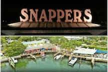 Snappers Waterfront Restaurant & Bar. Just a 5 minute Boat or bike ride away.