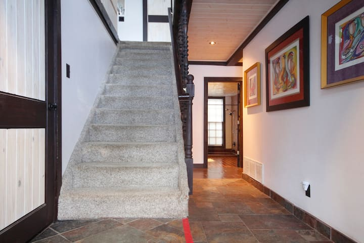 Stair case going from 1st floor where bedrooms are located, up to 2nd floor where the main living is located.
