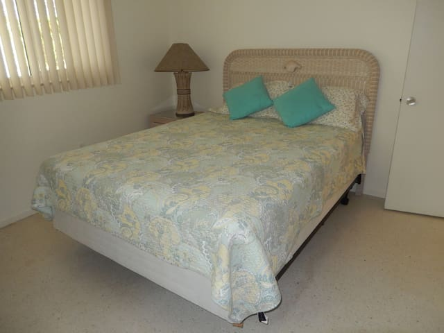 Second queen bedded room with two closets