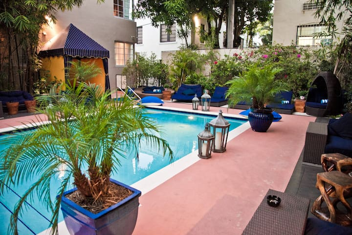 Guest Room with a Balcony, One Queen Bed, Two Gorgeous Pools and Rooftop Sundeck, One Minute Walk to the Beach