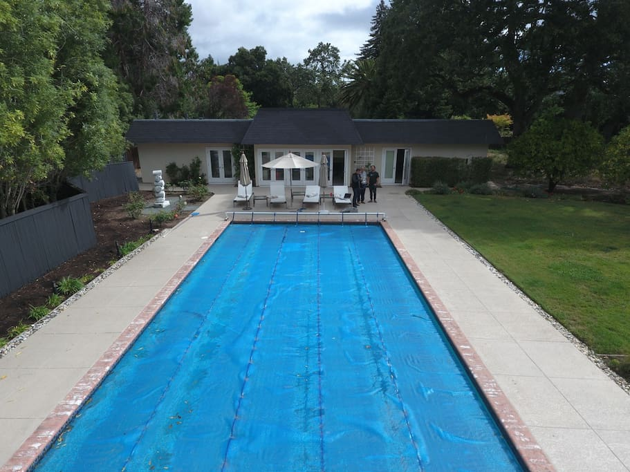 Drone's eye view of the pool and guest house