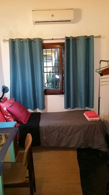 Single bed, night lamp, blankets, towels