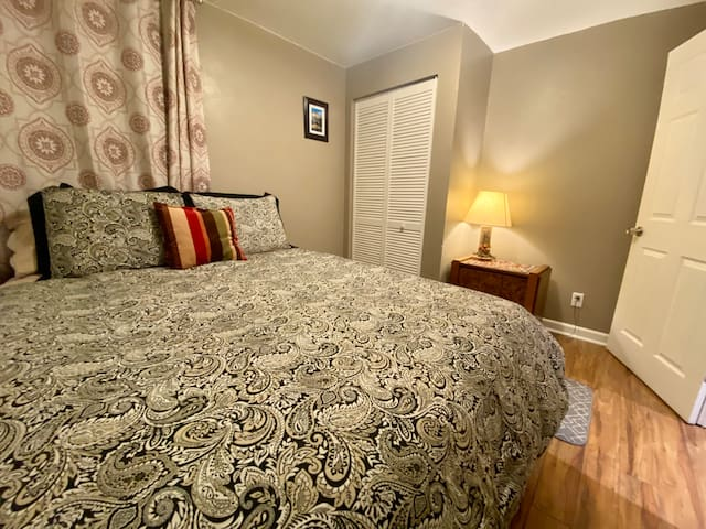 Queen size bed in smaller bedroom